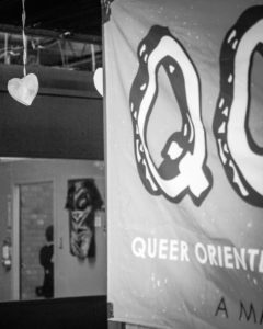 grayscale cropped view of a hanging QORDS banner